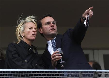 Elisabeth Murdoch (L) talks to her brother James Murdoch, Chairman and Chief Executive of News Corp, Europe and Asia, at Cheltenham Festival horse racing meet in Gloucestershire, western England March 18, 2010. REUTERS/ Eddie Keogh