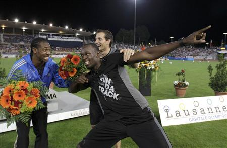 Jamaica's Usain Bolt celebrates with his compatriot Yohan Blake (L) during the Athletissima Diamond League meeting in Lausanne August 23, 2012. REUTERS/Denis Balibouse