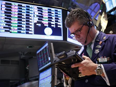 Traders work on the floor of the New York Stock Exchange, August 23, 2012. REUTERS/Brendan McDermid