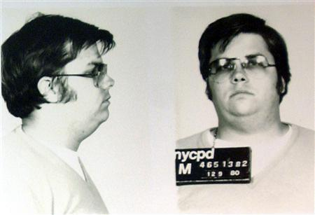 A mug-shot of Mark David Chapman, who shot and killed John Lennon, is displayed on the 25th anniversary of Lennon's death at the NYPD in New York December 8, 2005. REUTERS/NYCPD/Handout
