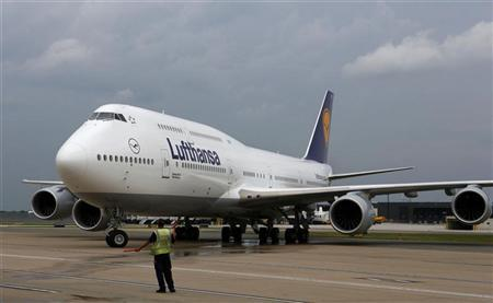 A Lufthansa Boeing 747-8 taxis after landing at Dulles International Airport, outside Washington for the first time June 1, 2012. REUTERS/Larry Downing