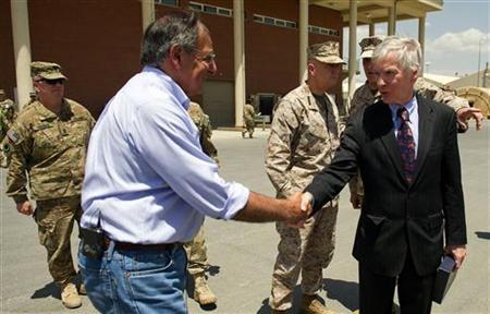 U.S. Secretary of Defense Leon Panetta (L) shakes hands with former U.S. Ambassador to Afghanistan Ryan Crocker before departing Kabul International Airport June 7, 2012. REUTERS/Jim Watson/Pool