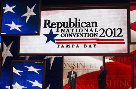 Republican National Committee Chairman Reince Priebus (C) unveils the stage for the upcoming Republican National Convention alongside convention Chief Executive Officer William Harris in Tampa, Florida August 20, 2012. REUTERS/Scott Audette