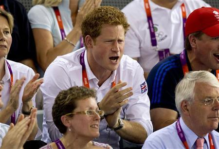Britain's Prince Harry (C) reacts as Britain's Laura Trott wins gold in the women's track cycling omnium at the Velodrome during the London 2012 Olympic Games August 7, 2012. REUTERS/Neil Hall