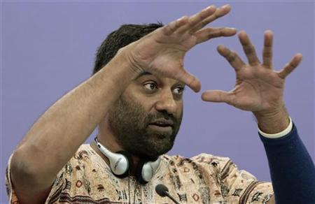 Kumi Naidoo, Executive Director of Greenpeace International, gestures during a news conference in Moscow August 14, 2012. REUTERS/Maxim Shemetov