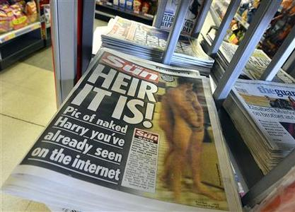 A copy of The Sun newspaper featuring a picture of a naked Prince Harry is seen in a shop in London August 24, 2012. TREUTERS/Toby Melville