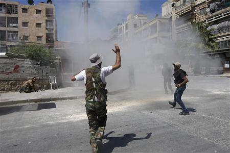 Free Syrian Army fighter gesture as they fire a launcher towards regime forces in the Seif El Dawla neighbourhood of Syria's south west city of Aleppo August 24, 2012. REUTERS/Youssef Boudlal