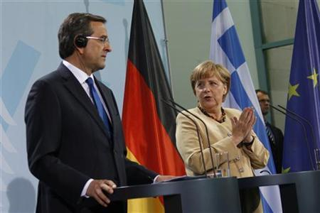 German Chancellor Angela Merkel (R) and Greek Prime Minister Antonis Samaras attend a news conference after talks at the Chancellery in Berlin, August 24, 2012. REUTERS/Thomas Peter