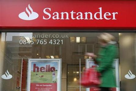 A pedestrian walks past a branch of a Santander bank in London, January 11, 2010. REUTERS/Suzanne Plunkett