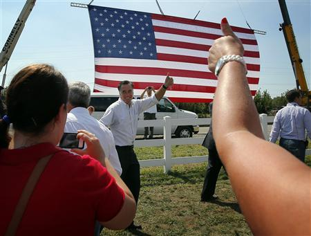 Republican presidential candidate and former Massachusetts Governor Mitt Romney gives a thumbs-up as he departs a campaign rally at the Long Family Orchard and Farm in Commerce, Michigan August 24, 2012. REUTERS/Brian Snyder