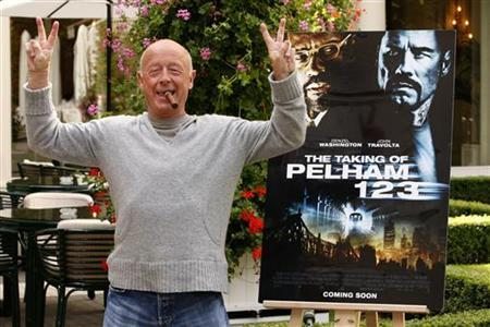 Director Tony Scott poses during a photocall to promote his lastest film ''The Taking of Pelham 123'' in Paris July 20, 2009. REUTERS/Benoit Tessier