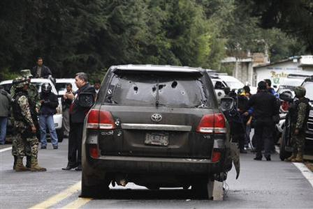 A bullet-riddled armoured U.S. embassy SUV is seen on a road near the town of Tres Marias, on the outskirts of Cuernavaca August 24, 2012. REUTERS/Margarito Perez