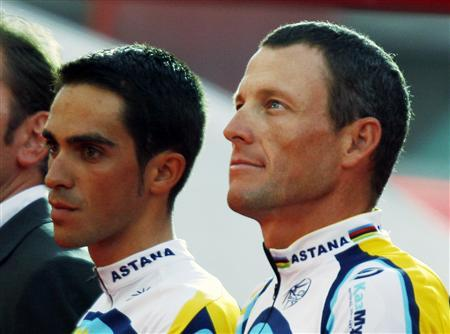 Astana rider Lance Armstrong of the U.S. stands on the podium with his team mate Alberto Contador of Spain during the team presentation ahead of the start of the 96th Tour de France cycling race in Monaco, in this July 2, 2009 file photo. REUTERS/Charles Platiau/Files