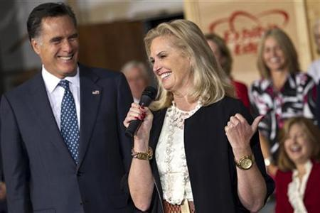 Republican presidential candidate and former Massachusetts Governor Mitt Romney smiles as his wife Ann Romney speaks during a campaign event at the Exhibit Edge building in Chantilly, Virginia May 2, 2012. REUTERS/Benjamin Myers
