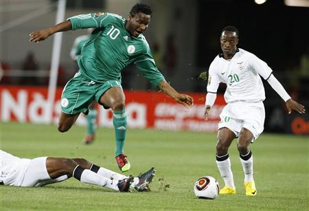 Nigeria's John Obi Mikel chases the ball as Zambia's William Njobvu looks on during their Africa Nations Cup quarter finals match in Lubango, January 25, 2010. REUTERS/Finbarr O'Reilly