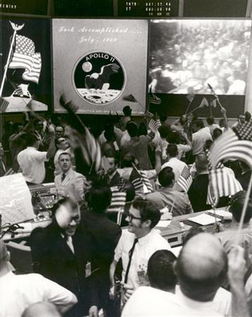 This NASA file image shows flight controllers celebrating the successful conclusion of the Apollo 11 lunar landing mission at the Mission Operations Control Room at the Johnson Space Center on July 24, 1969. REUTERS/NASA/Handout
