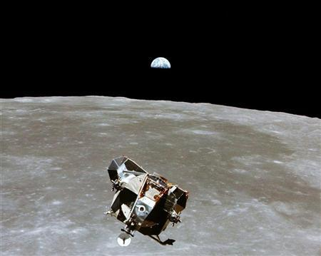 FILE PHOTO JULY 1969 - The Apollo 11 Lunar Module ascent stage, with astronauts Neil A. Armstrong and Edwin E. Aldrin Jr. aboard, is photographed from the Command and Service Modules in lunar orbit in this July, 1969 file photo. SV/JP