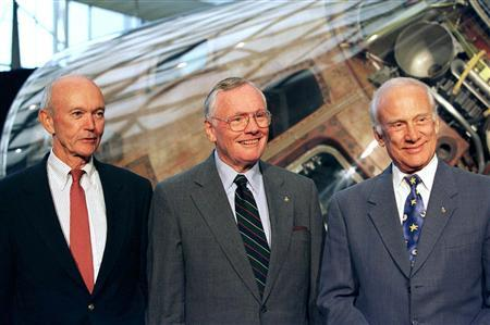The astronauts of Apollo 11, Neil Armstrong, Edwin ''Buzz'' Aldrin (R) and Michael Collins (L), received medals for their pioneering flight and stand in front of the command module Columbia which carried them on their historic flight, at The Air and Space Smithsonian 30 years after they first walked on the moon, in Washington, in this July 21, 1999, file photo. REUTERS/Jamal Wilson/Files