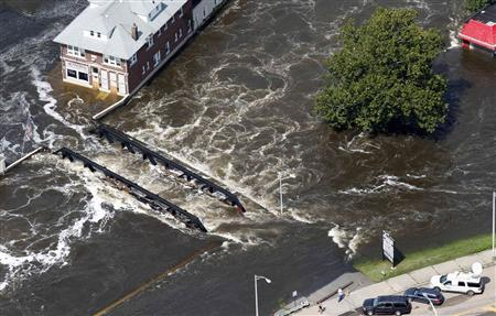 Flood waters from the Passaic River engulf a bridge days after Hurricane Irene in Paterson, New Jersey in this August 31, 2011 file photo. REUTERS/Brendan McDermid/Files