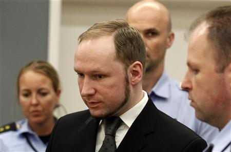 Norwegian mass killer Anders Behring Breivik reacts as he returns after a break to the court room, in Oslo Courthouse August 24, 2012. REUTERS/Stoyan Nenov