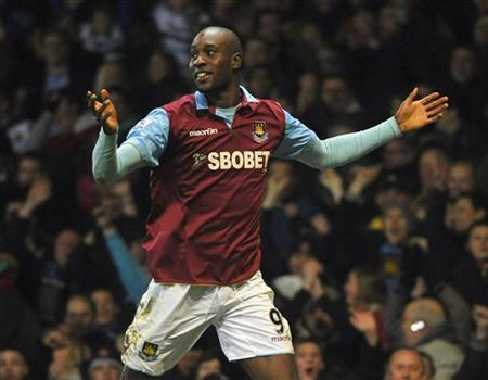 West Ham United's Carlton Cole celebrates scoring during their FA Cup soccer match against Burnley at Upton Park in London February 21, 2011. REUTERS/Toby Melville