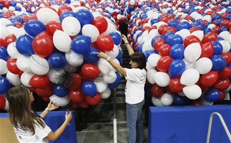 Workers prepare balloons to be dropped from the ceiling at the Republican National Convention in Tampa, Florida August 24, 2012. The convention starts Monday August 27, 2012. REUTERS/Rick Wilking