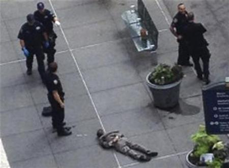Police look on after shooting gunman Jeffrey Johnson near the Empire State Building in New York August 24, 2012. Two people were killed and at least eight wounded in a shooting outside New York City's Empire State Building on Friday, creating chaos and shocking tourists and commuters who witnessed the bloody scene outside the tourist attraction. A 53-year-old fashion accessories designer, disgruntled over being fired a year ago, shot and killed a 41-year-old former co-worker three times with a .45 caliber handgun on a sidewalk near the landmark building, officials said. REUTERS/Guillermo Ratzlaff
