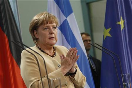 German Chancellor Angela Merkel gestures during a news conference after talks with Greek Prime Minister Antonis Samaras at the Chancellery in Berlin, August 24, 2012. REUTERS/Thomas Peter