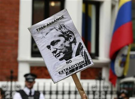 A placard is held by a supporter of Julian Assange outside the Ecuador embassy in west London, August 16, 2012. REUTERS/Olivia Harris