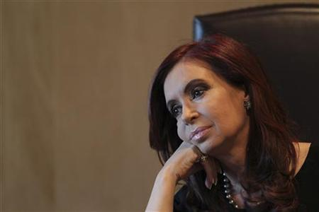 Argentina's President Cristina Fernandez de Kirchner attends a meeting with her Venezuelan counterpart Hugo Chavez (not pictured) to sign agreements between Venezuela and Argentina, at the Argentine Embassy in Brasilia July 31, 2012. REUTERS/Ueslei Marcelino