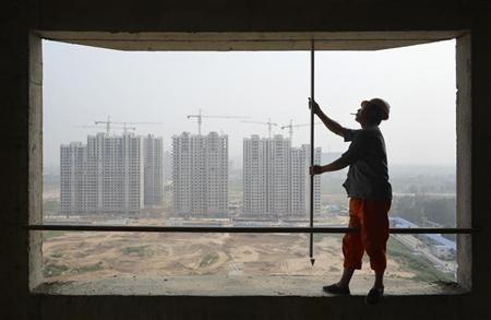 A labourer works at a construction site of a residential complex in Taiyuan, Shanxi province July 19, 2012. REUTERS/Stringer