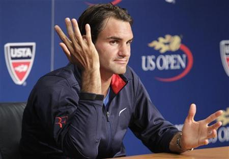 Switzerland's Roger Federer answers questions at a news conference ahead of the 2012 U.S. Open tennis tournament in New York August 25, 2012. REUTERS/Eduardo Munoz