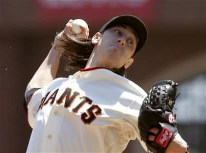 San Francisco Giants starting pitcher Tim Lincecum throws a pitch against the Washington Nationals during the second inning of the MLB baseball game in San Francisco, California August 15, 2012. REUTERS/Robert Galbraith