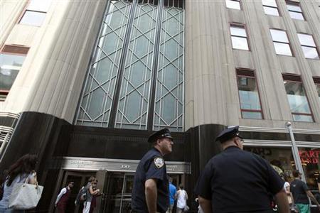 New York City Police officers stand at their post in front of the Empire State Building in New York, August 25, 2012. REUTERS/Keith Bedford