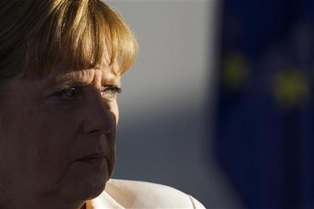 German Chancellor Angela Merkel addresses the media before talks with France's President Francois Hollande (not pictured) at the Chancellery in Berlin, August 23, 2012. REUTERS/Thomas Peter