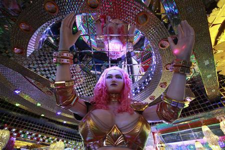 A 3.6 metre-high custom-made female robot is pictured at the newly opened ''Robot Restaurant'' in Kabukicho, one of Tokyo's best known red light districts, August 16, 2012. REUTERS/Yuriko Nakao