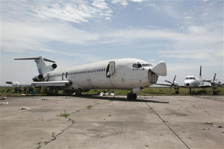 An abandoned aircraft stands at Kinshasa's Ndjili International Airport April 13, 2012. REUTERS/Jonny Hogg