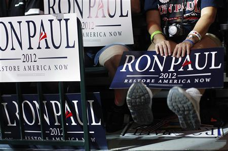 Supporters of U.S. Republican presidential candidate, Congressman Ron Paul, hold signs during a rally at the University of South Florida in Tampa, Florida August 26, 2012. REUTERS/Shannon Stapleton