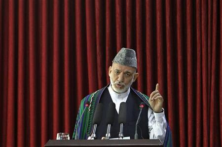 Afghanistan's President Hamid Karzai speaks at a gathering of the Women Judges Association in Kabul July 18, 2012. REUTERS/Omar Sobhani