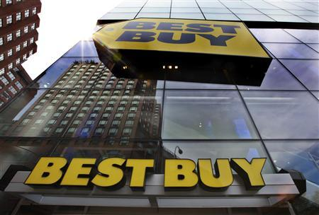 A building is reflected in the glass of a Best Buy store in New York in this August 21, 2012, file photo. REUTERS/Brendan McDermid/Files