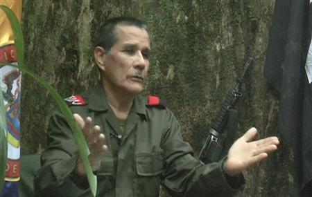 Colombian guerrilla group National Liberation Army (ELN) commander Nicolas Rodriguez, known as ''Gabino'', gestures as he speaks in response to questions from Reuters at a hidden jungle camp in this still image taken from an undated video released August 27, 2012. REUTERS/ELN via Reuters TV