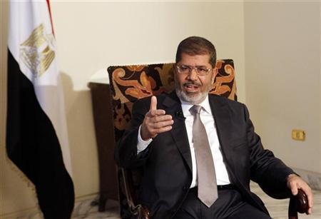 Egyptian President Mohamed Mursi talks during an interview with Reuters at the Presidential palace in Cairo, August 27, 2012. REUTERS/Asmaa Waguih