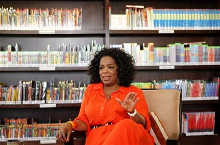 Talk show queen Oprah Winfrey gestures during an interview with Reuters at her Oprah Winfrey Leadership Academy for Girls in Henley-on-Klip, outside Johannesburg January 12, 2012. REUTERS/Siphiwe Sibeko