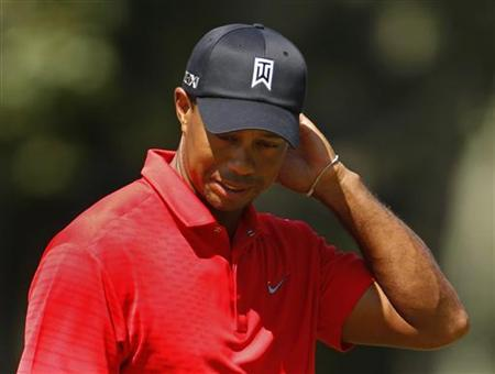 Tiger Woods of the U.S. reacts to missing a putt on the 9th hole during the final round of the Barclays PGA golf tournament on the Black Course, at Bethpage State Park in Farmingdale, New York August 26, 2012. REUTERS/Adam Hunger