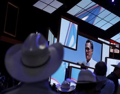 Delegates look at an image of U.S. Republican presidential candidate and former Massachusetts Mitt Romney displayed during the opening session of the Republican National Convention in Tampa, Florida, August 27, 2012. REUTERS/Shannon Stapleton