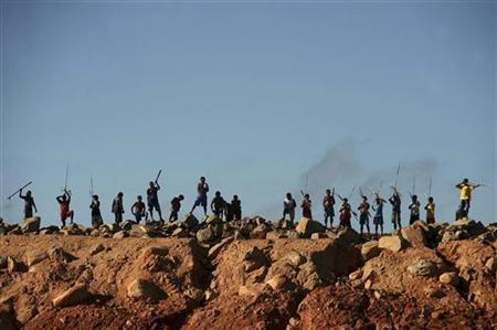 A group of Amazon Indians protests on an earth barrier that is part of the construction of the massive Belo Monte hydroelectric dam, in Vitoria do Xingu July 7, 2012. REUTERS/Lunae Parracho