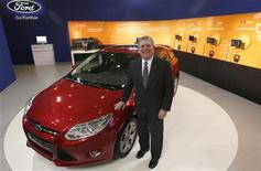 Dave Schoch, chairman and CEO of Ford Greater China, poses in Ford's booth in Taipei June 4, 2012. REUTERS/Pichi Chuang