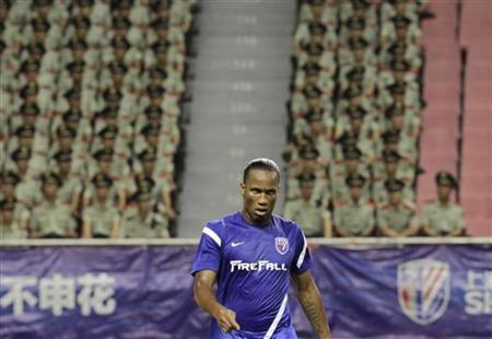 Shanghai Shenhua's striker Didier Drogba reacts during the Chinese Super League match against Hangzhou green town at the Shanghai Hongkou Stadium in Shanghai, August 4, 2012. REUTERS/Aly Song