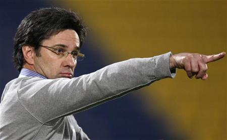 Al-Gharafa's head coach Caio Junior of Brazil gestures during their AFC Champions League soccer match against Al-Ahli at the Al-Gharfa stadium in Doha, March 9, 2010. REUTERS/Fadi Al-Assaad
