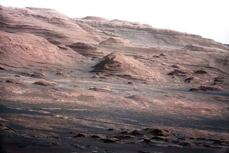 The base of Mars' Mount Sharp - the rover's eventual science destination - is pictured in this August 27, 2012 NASA handout photo taken by the Curiosity rover. REUTERS/NASA/Handout